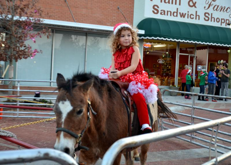 Rachael Law enjoys pony rides on the Square in Sulphur Springs.
