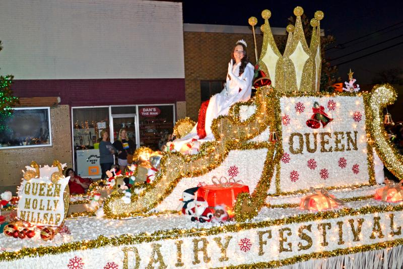 Dairy Festival Queen Molly Millsap waves to the crowds lining Connally Street in Sulphur Springs.