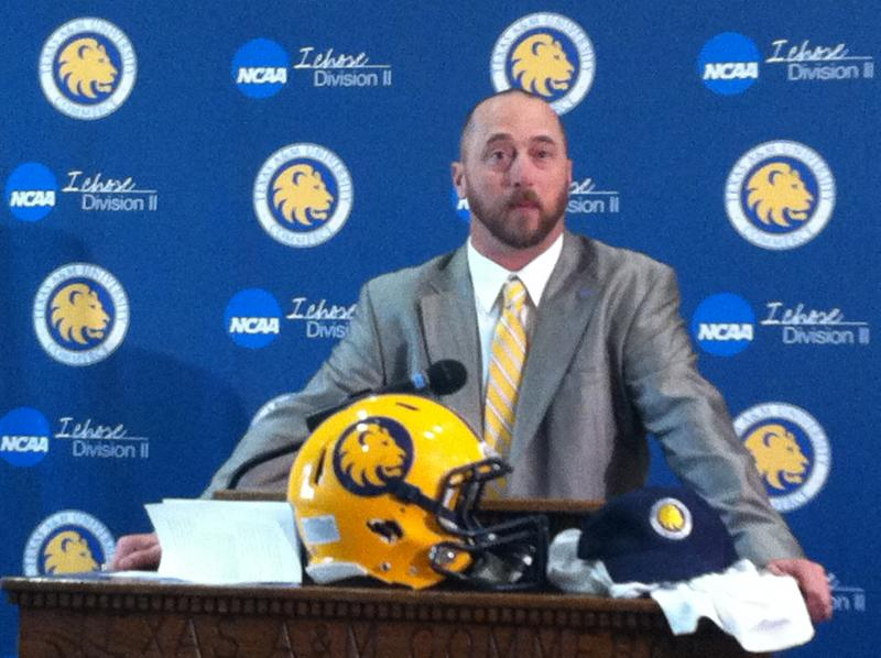Colby Carthel, newly hired as Texas A&M University-Commerce's head football coach, addresses a press conference on campus Tuesday. Carthel had spent the last seven seasons as the defensive coordinator at West Texas A&M.