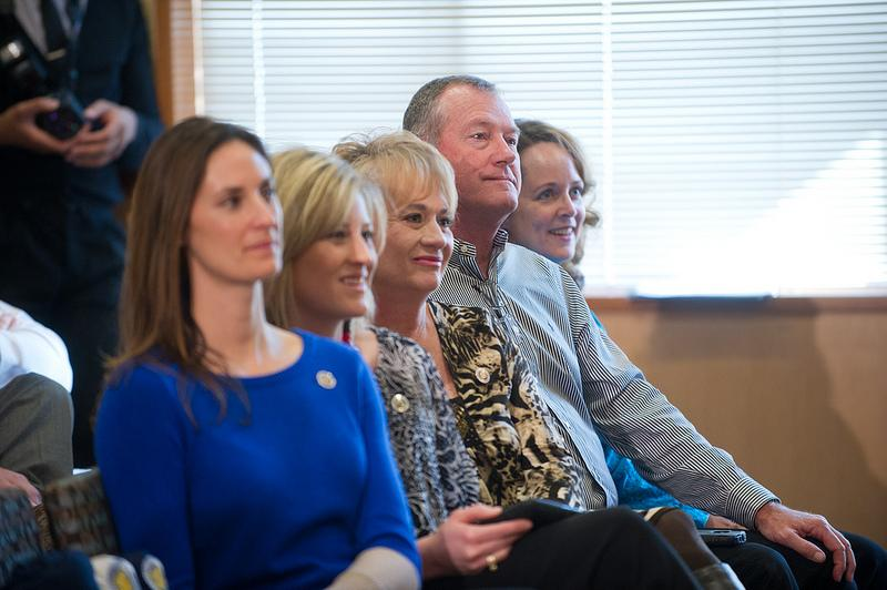 Colby Carthel's parents, Cindy and Don Carthel, center and center right, watch their son address Texas A&M University-Commerce football supporters at the announcement of his hiring as head coach. Don Carthel is head football coach at West Texas A&M.