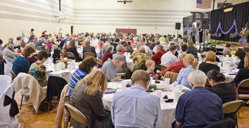 Participants pray during the Sulphur River Go Tell Crusade Kick-off Banquet held Feb. 18 in Cooper.