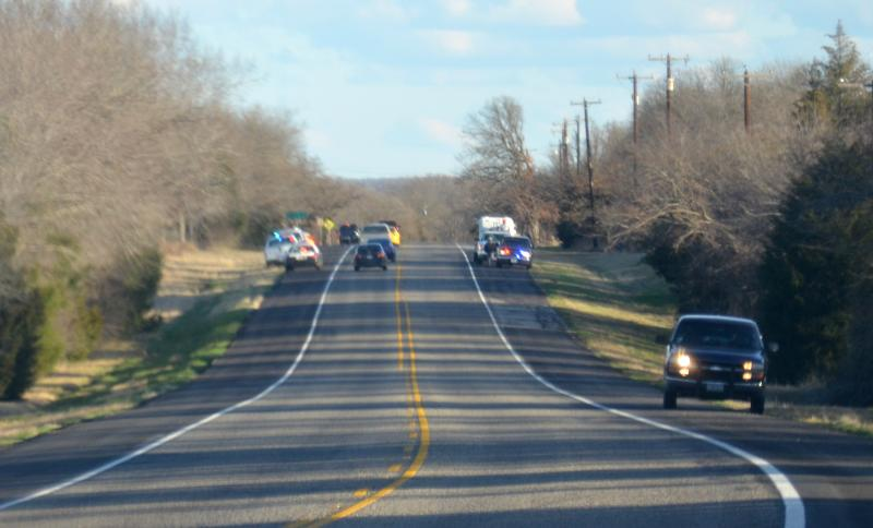 Law enforcement officials along State Hwy. 19 during Wednesday's manhunt.