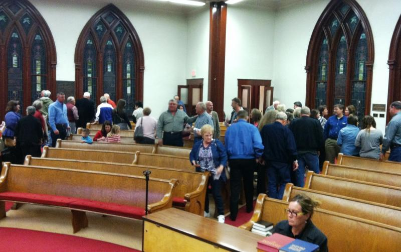 After the service, congregants of Mackenzie Methodist and Main Street Presbyterian exchanged thanks and discussed the week's events.