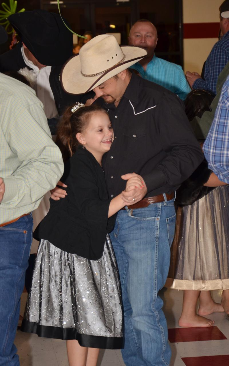 "North Hopkins ISD fourth grader Katelyn Roach dances with her stepfather Scotty Nguyen at the ""That's my girl"" dance Feb. 9 in Hopkins County."