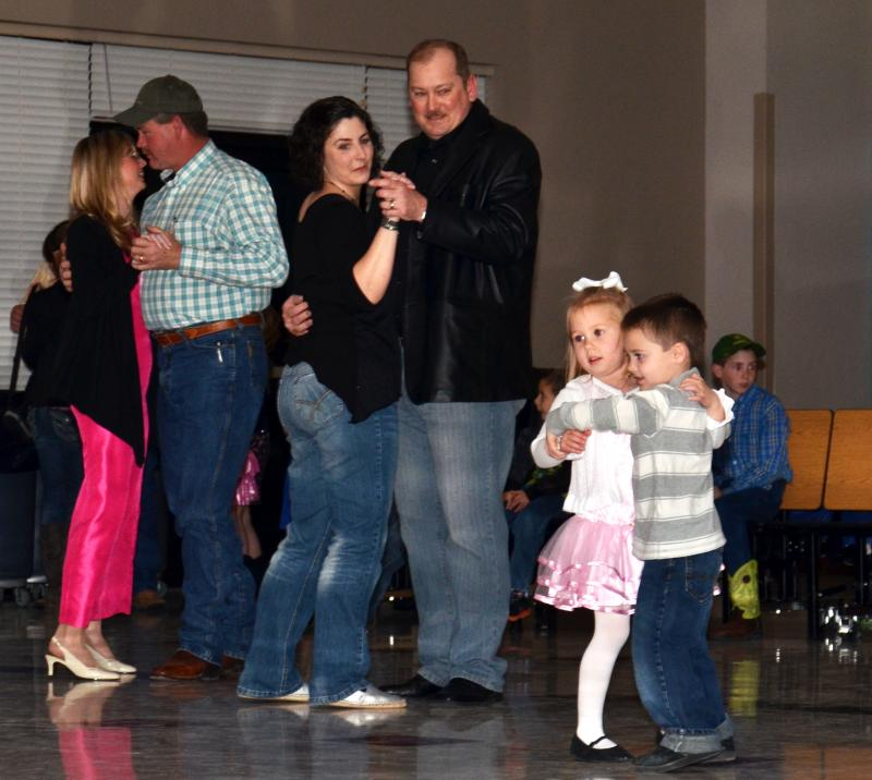 Harry and Amy Patrick dance alongside Benton Goodson and Lexie Reed at Cooper PTO's Winter Wonderland Family Dance held Feb. 16.