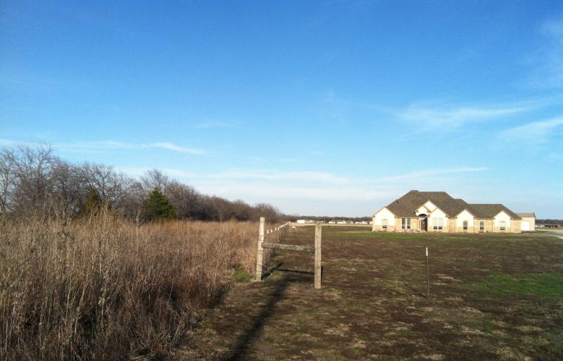 The proposed toll road would follow the route of the old railroad line, which borders many homes in western Hunt County.