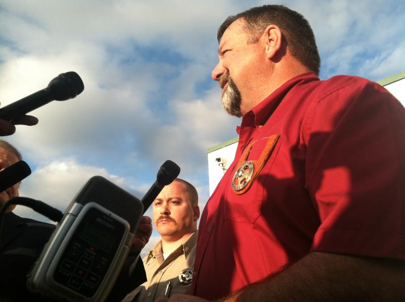Hopkins County Sgt. Brad Cummings, left, and Sheriff Butch Adams, right foreground, speak with the media Thursday evening.