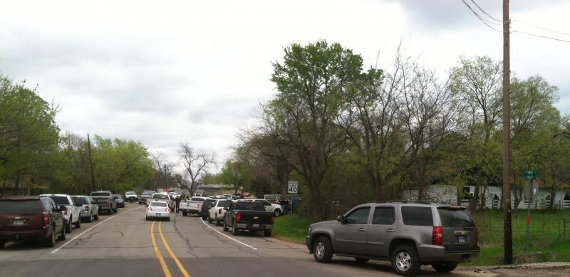 Official vehicles crowd E. Dallas Ave. in Cooper near the site of Thursday afternoon's raid.