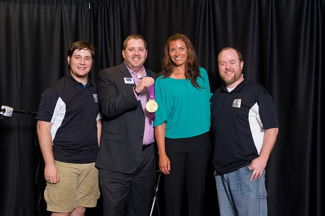 Misty May-Treanor with KETR Staff.  (L to R) Daniel Starks, Jerrod Knight, May-Treanor, Kevin Jefferies