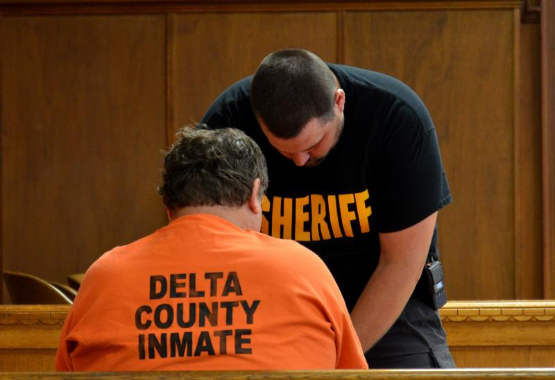 Delta County jailer Wesley Mayeux, right, works with an inmate at the Delta County Courthouse in Cooper on May 1.
