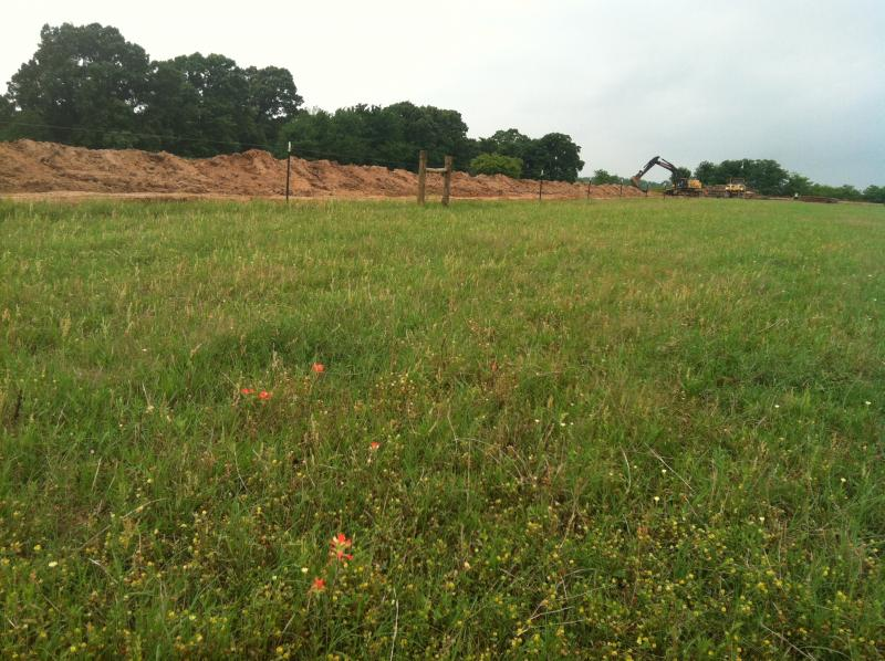 Crews ready the site for heavier equipment at the farm in Direct, Texas.