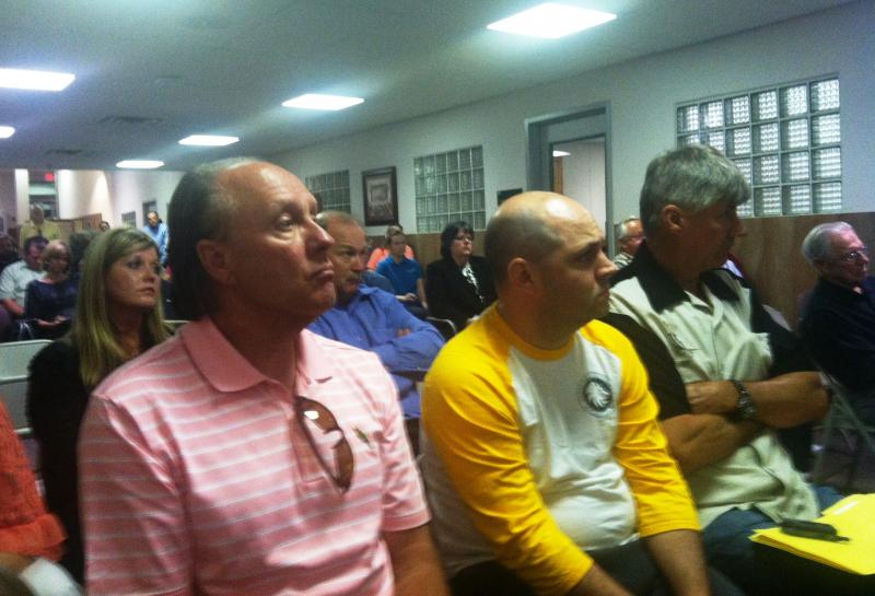 A somber crowd of citizens stayed late into the evening to hear the council's decision.