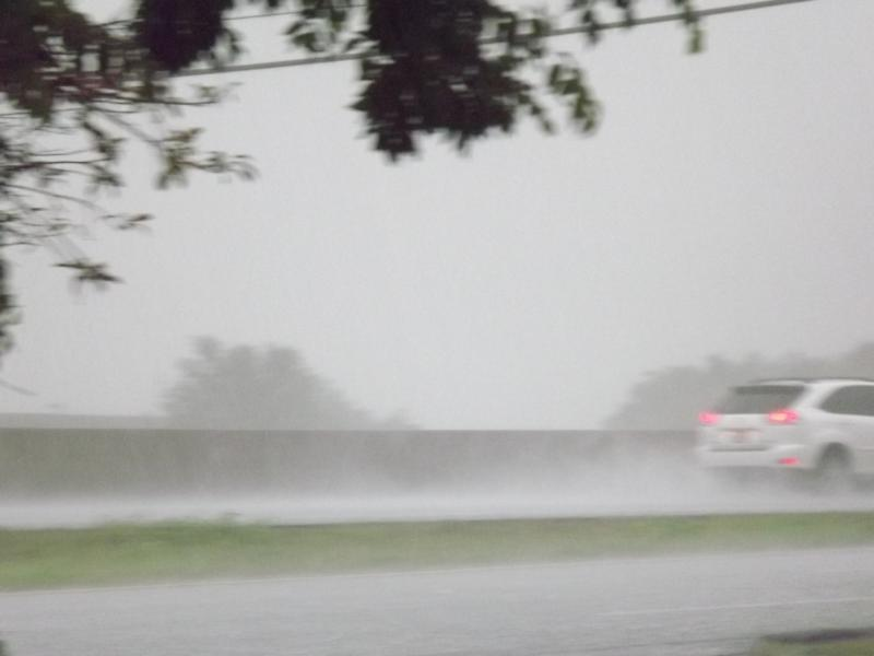 Rainwater floods the Interstate 30 access road between exits 93 and 94.