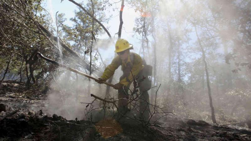 U.S. Forestry Service firefighter Samantha McKelvy working near Bastrop in 2011.