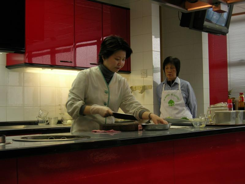 Instructor demonstrates the proper ways to make the dishes during the food class