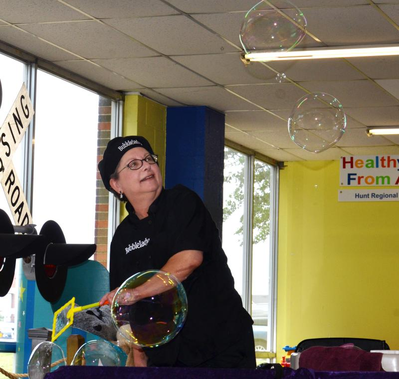 """Bubble Lady"" Linda Berman entertains children at the Northeast Texas Children's Museum in Commerce on July 10."
