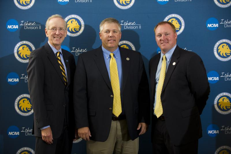 Head Softball Coach Richie Bruister standing with A&M-Commerce President Dr. Dan Jones and Athletic Director Ryan Ivey