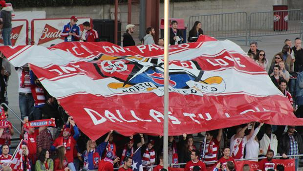 Supporters group culture: North End United, a collaboration of the four major FC Dallas supporters groups, unveil a tifo during last year's match against Chivas USA.
