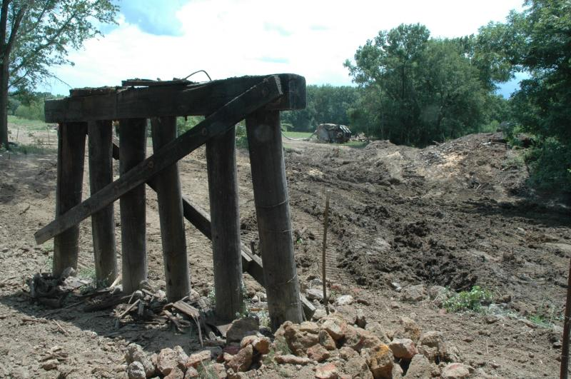 Remnants of the railroad bridge stand at the site where crews have been working following the partial derailment of a freight train near Mount Vernon.