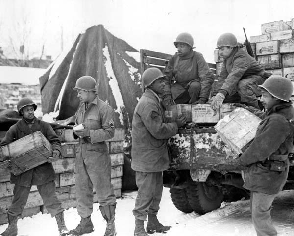 Sometimes the servicemen themselves did the loading and unloading, though German prisoners often performed the task.