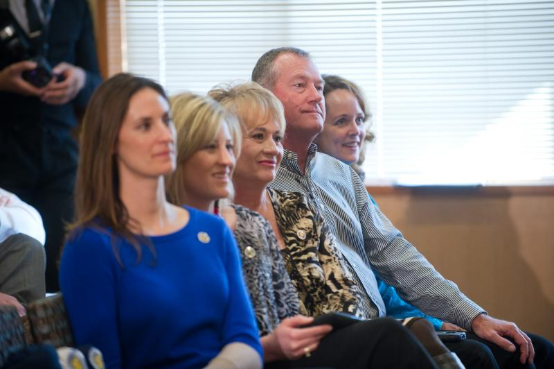 Don Carthel and family members watch Colby Carthel address attendees at the announcing of Colby Carthel's hiring as head football coach at Texas A&M University-Commerce in January 2013.
