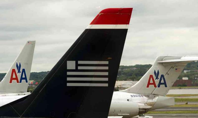 Greg Abbott, the attorney general of Texas, announced this week that he had filed a complaint in federal court to block a merger between American Airlines and U.S. Airways.