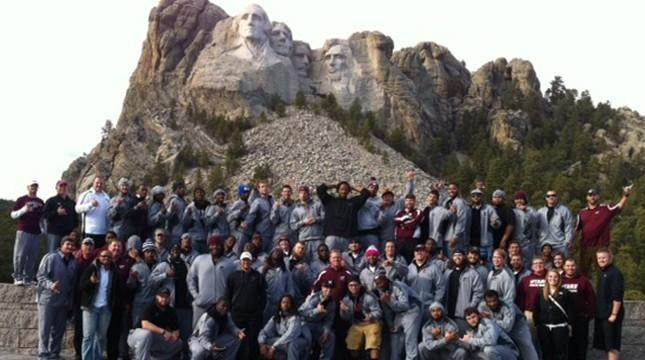 The 2012 Buffaloes pose for a photo at Mount Rushmore National Memorial, near Keystone, S.D. Colby Carthel is at top right.