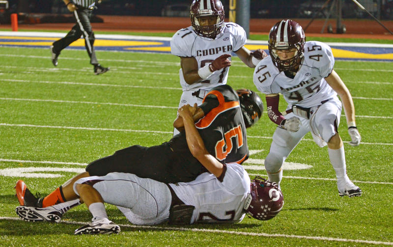 The Bulldogs' Jadon McGraw brings down a Commerce ball carrier during a Sept. 6 game at Commerce.