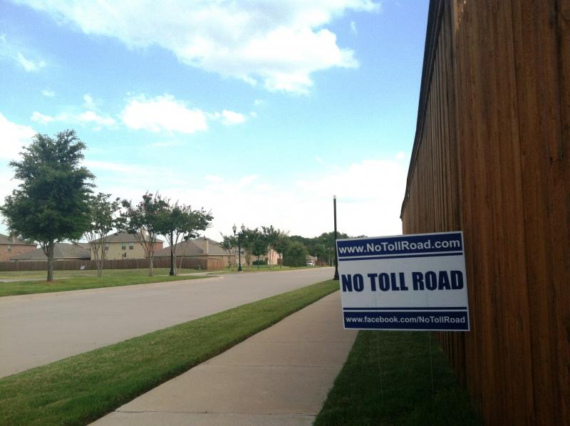 A sign opposing a toll road in the Blacklands Corridor greets motorists near the site of a July 25 public meeting on the topic in Lavon.