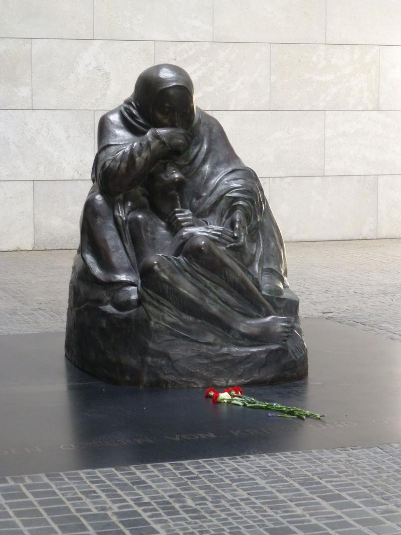 A visitor left a single flower at the Tomb of the Unknown Soldier and Concentration Camp Victim