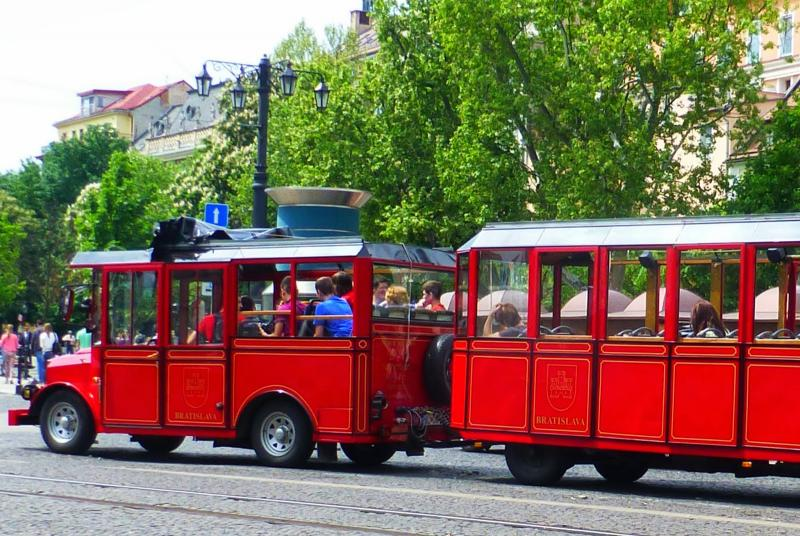 This red Mini-train carries tourists to the sights in Slovakia.