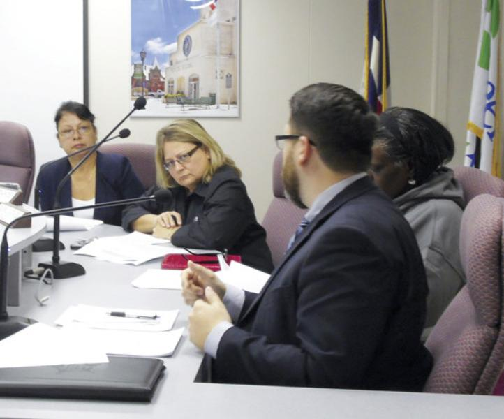 Greenville City Council members Velma Del Bosque-Hobdy, Renee Francey and Sandas Linson-Bell listen as City Attorney Daniel Ray goes over the details of an economic development agreement which would bring a Splash Kingdom water park to Greenville.