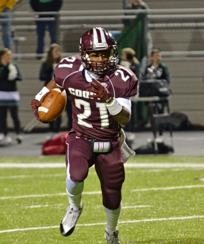 The Bulldogs' Darmarcus Robinson carries against Scurry-Rosser.