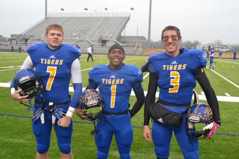 Leonard seniors Ty McKinney, Solomon Titus, and Justin Bennett (pictured left to right) helped the Tigers post a 28-20 upset of previously undefeated Cooper Monday afternoon in a 2A quarter-final game played at the Royce City ISD football stadium.