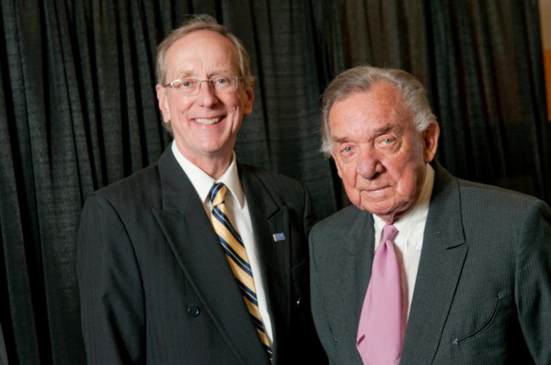 Texas A&M University-Commerce President Dr. Dan Jones poses with Ray Price before the 2009 ceremony during which Price recieved an honorary Doctorate of Letters from the school.
