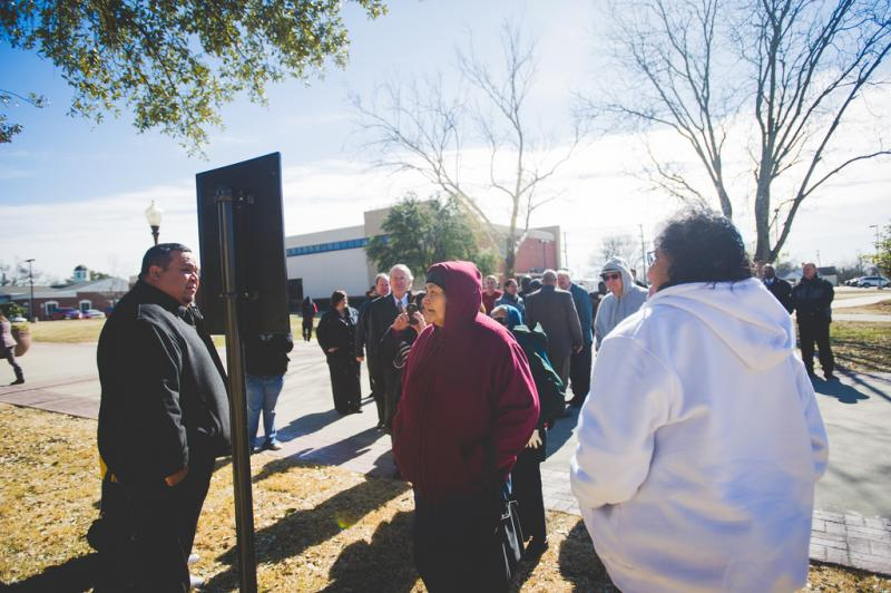 Caddo Tribal Council members, university officials and onlookers at the Jan. 28 ceremony.