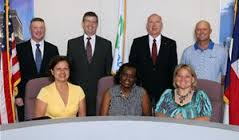 Current city council: (from L to R) Back row: Jeff Dailey, Dan Perkins, James Evans and Mayor Steve Reid. Front row: Velma Del Bosque-Hobdy, Sandra Linson-Bell and Renee Francey