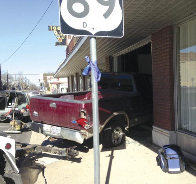 No one was injured in a Tuesday afternoon two vehicle accident which sent a pickup truck crashing into a downtown Greenville building.