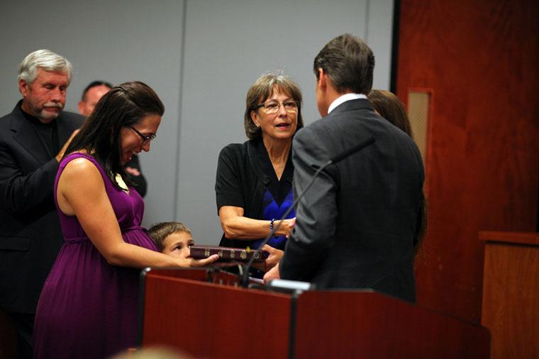 Mary Ann Williamson, center, was sworn in by Gov. Rick Perry to her new role at the Texas Water Development Board in September 2013. But Williamson resigned in January.