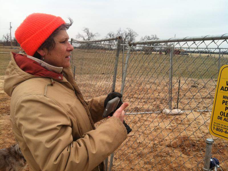 Lamar County landowner Julia Trigg Crawford inspects a TransCanada pipeline valve station on her property. The southern leg of the Keystone XL Pipeline is already operating, although the line is moving ordinary crude oil rather than tar sands.