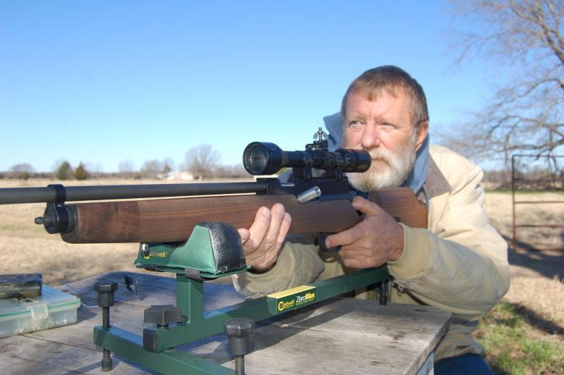 Custom big bore air rifle builder Terry Tate at the range testing one of his rifles.