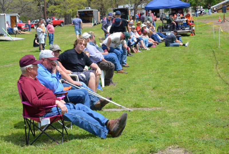 Crowd watches pull tractor competition.