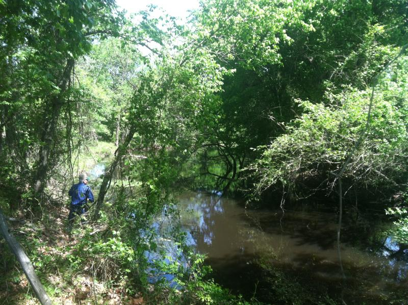 Gary Cheatwood at Cuthand Creek, in the proposed reservoir site.