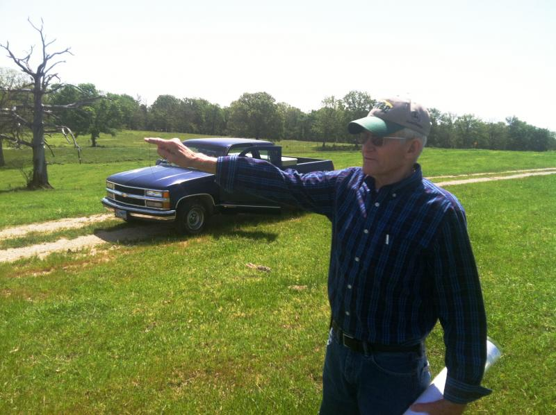 Gary Cheatwood points out landmarks in the proposed reservoir site.