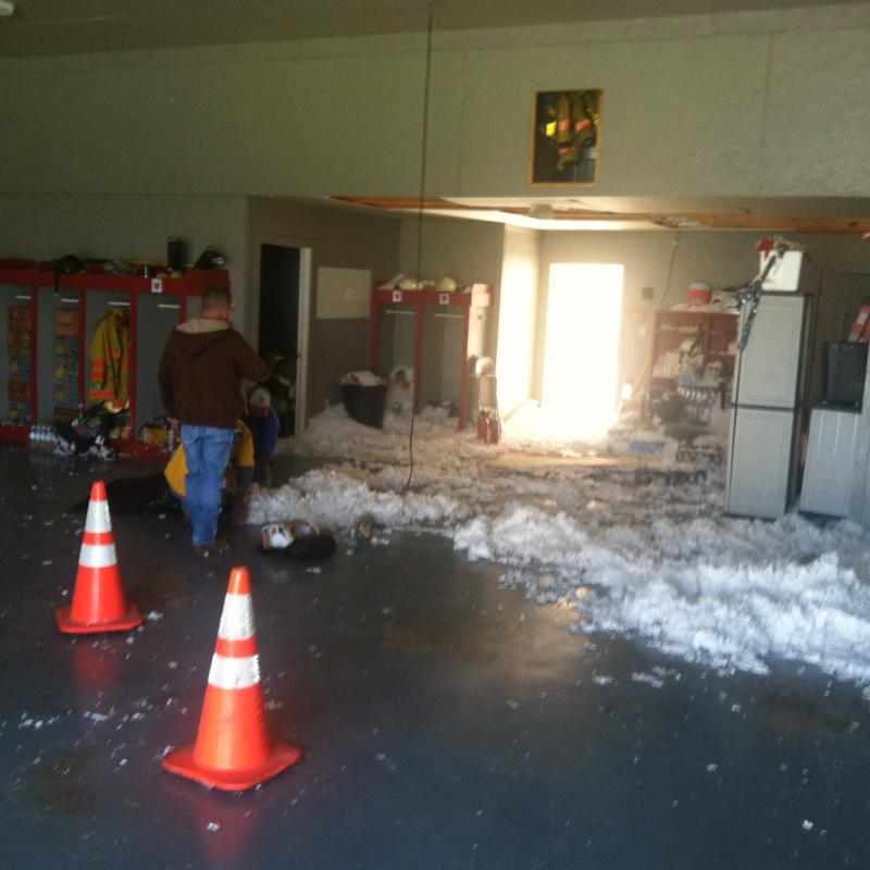 The North Hopkins Volunteer Fire Department's building was severaly damaged. Workers cleaned the vehicle bay on April 4.