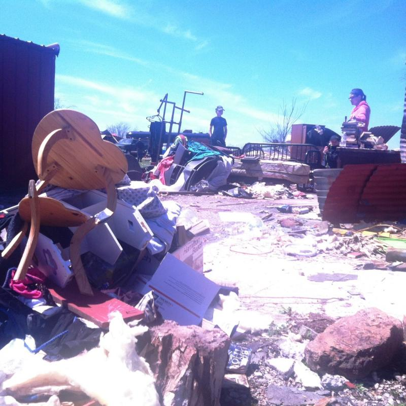Household items and building materials mixed in the debris from the storm.