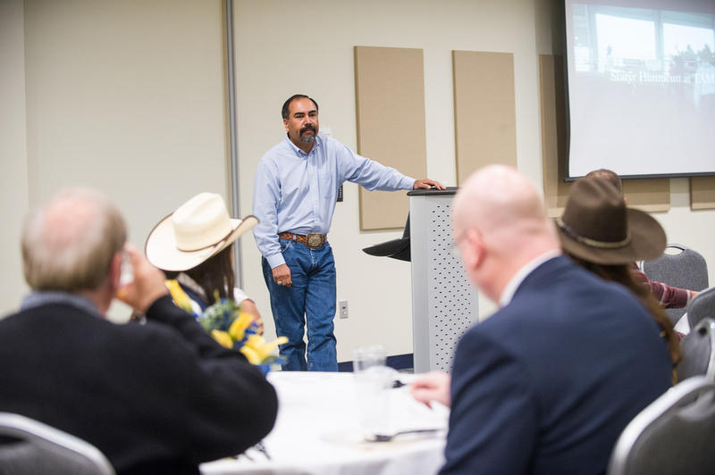 Dr. Edward Romero, Chief Diversity Officer and Rodeo Team advisor/coach makes a presentation at a rodeo team luncheon on the A&M-Commerce campus