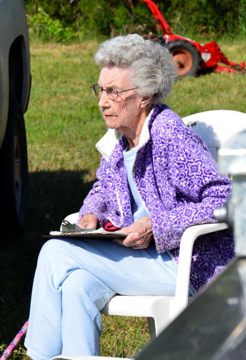93-year old volunteer Clarice Maddox oversees the cleanup at Simmons Cemetery in Ben Franklin last Tuesday morning.