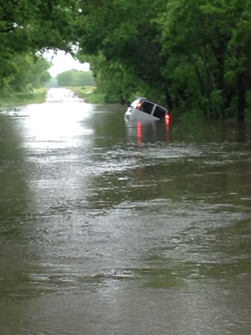 A vehicle was swept from CR 4509 north of Commerce during flash flooding on Thursday.