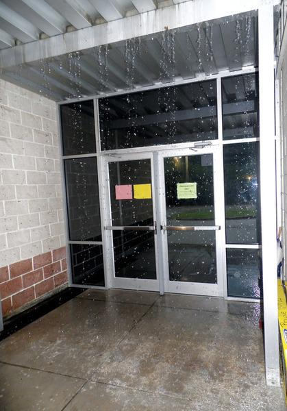 Heavy rains Thursday morning helped create a waterfall inside one of the exit doors at Bowie Elementary School.